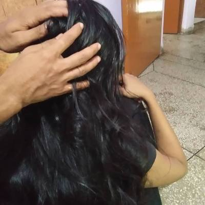 Coconut hair oil massage